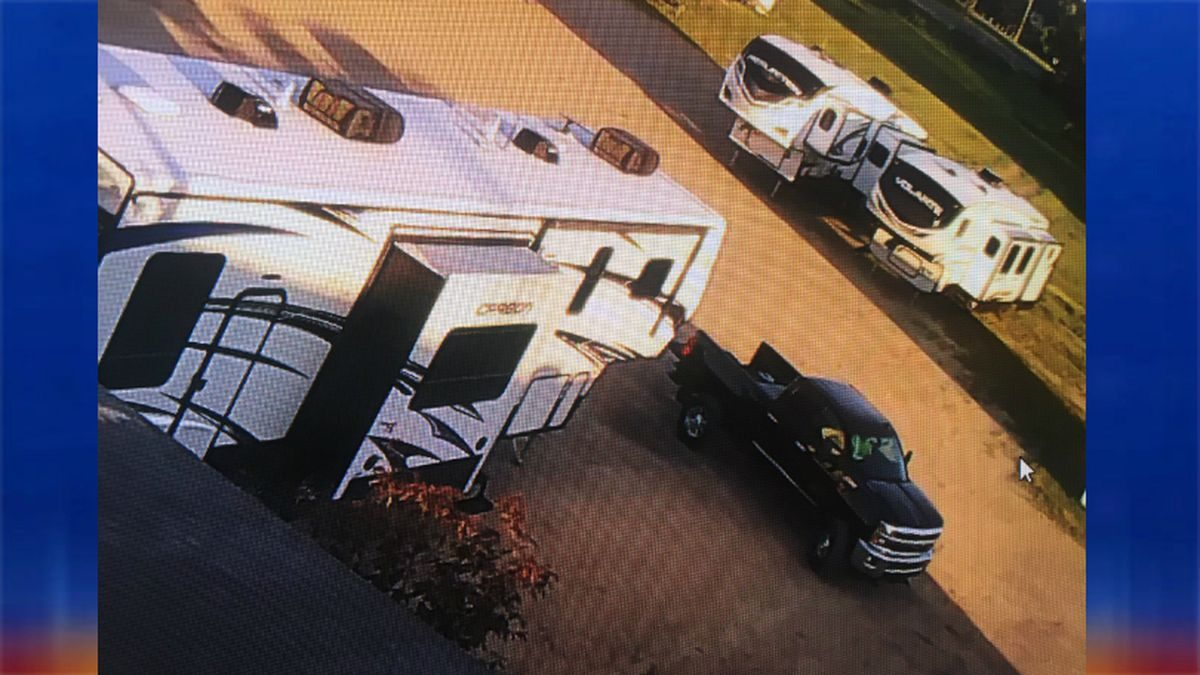 A security camera captured this Chevy pickup hitching up to a camper and stealing it from an RV sales lot.