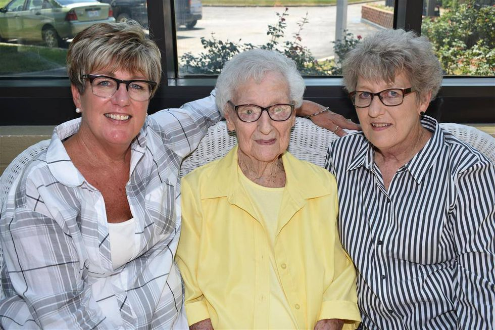 Betty Virginia Starke poses for a photo with her daughters Jill Starke and Carla Helmig. Betty Starke passed away from natural causes in September; prior to her passing, her daughters were unable to visit her Missouri nursing home for months due to the coronavirus pandemic.