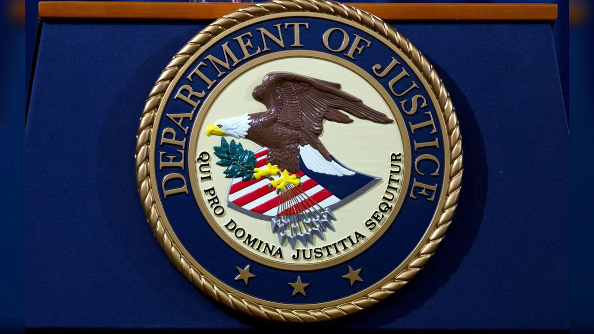 FILE - In this Nov. 28, 2018 file photo, the Department of Justice seal is seen in Washington,...