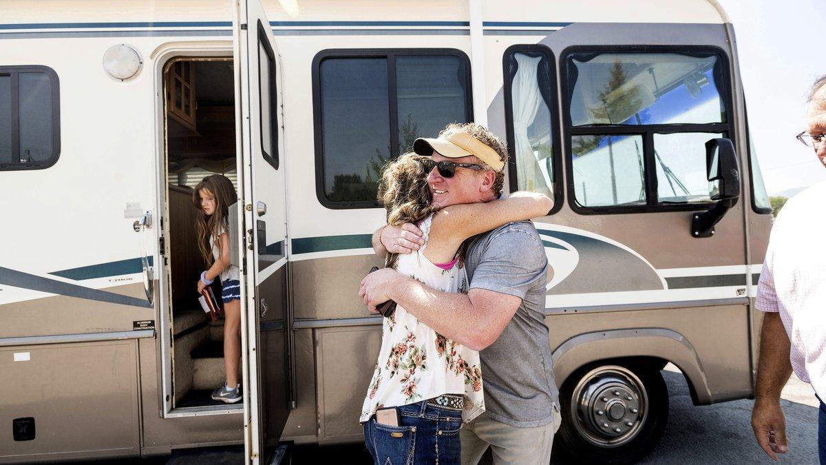 Woody Faircloth hugs Sheri Roen as her family donates their motorhome to EmergencyRV.org on...