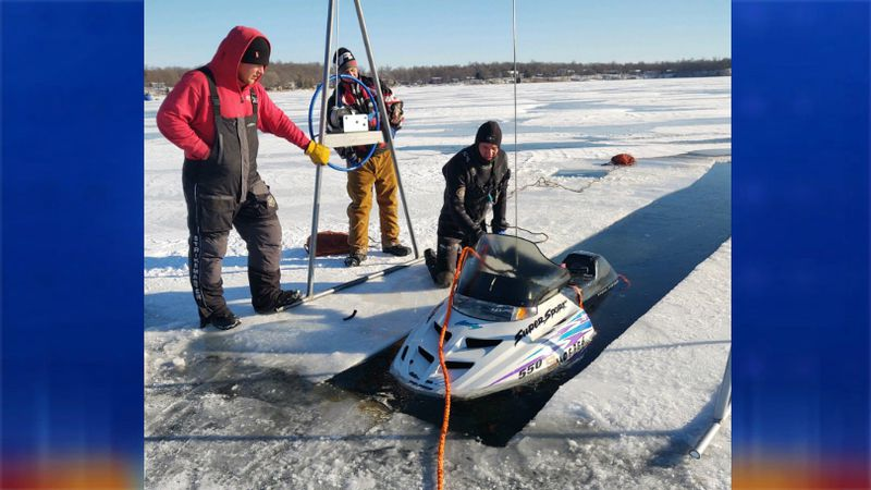 Crews pulled a snowmobile from Lake Maud near Audubon, MN.