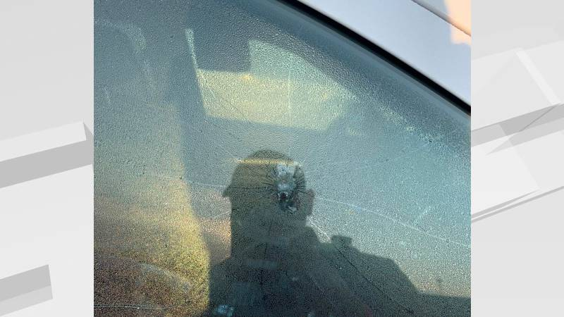 A bullet flew through the passenger window of a Ramsey County Sheriff's Dept. squad car.