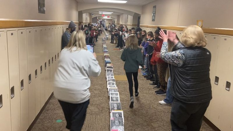 400 students decorated 600 cereal boxes with their teacher's faces and covered them with kind...