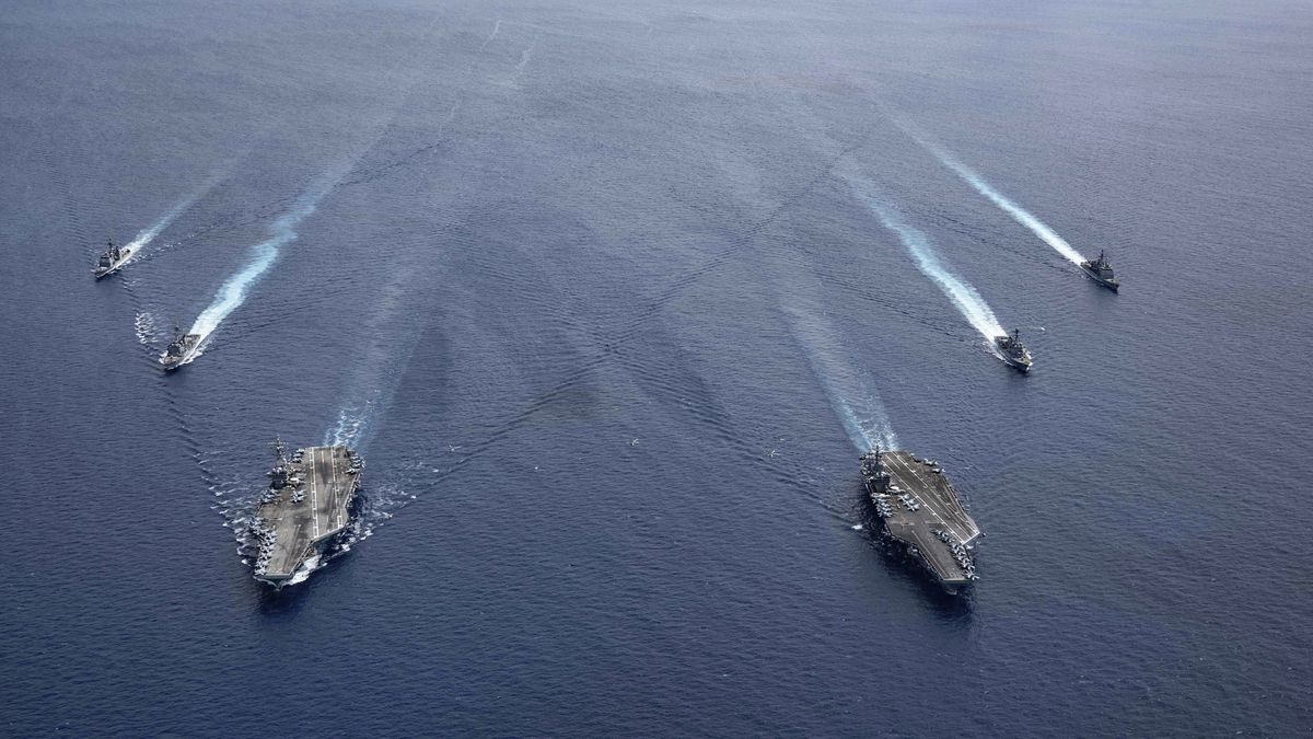 In this photo provided by U.S. Navy, the USS Ronald Reagan (CVN 76) and USS Nimitz (CVN 68) Carrier Strike Groups steam in formation, in the South China Sea, Monday, July 6, 2020. China on Monday, July 6, accused the U.S. of flexing its military muscles in the South China Sea by conducting joint exercises with two U.S. aircraft carrier groups in the strategic waterway.