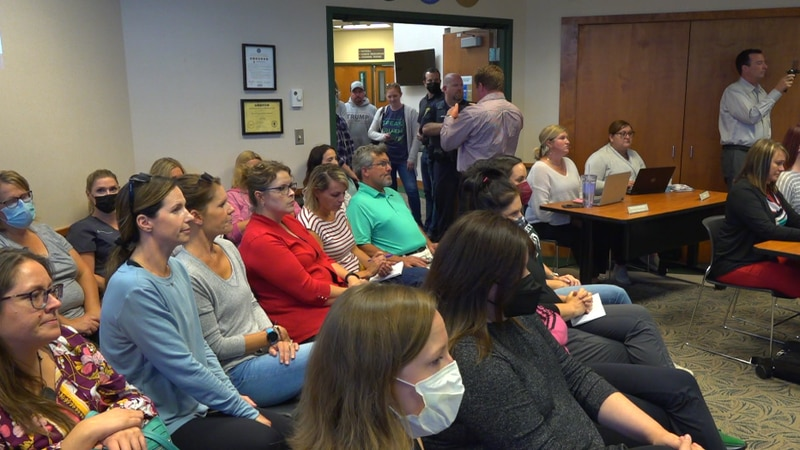 The room was packed at the West Fargo Public Schools School Board meeting where the board voted...