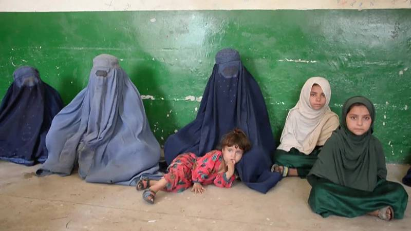 Unspecified health concerns have halted U.S.-bound flights of Afghan evacuees from two key...