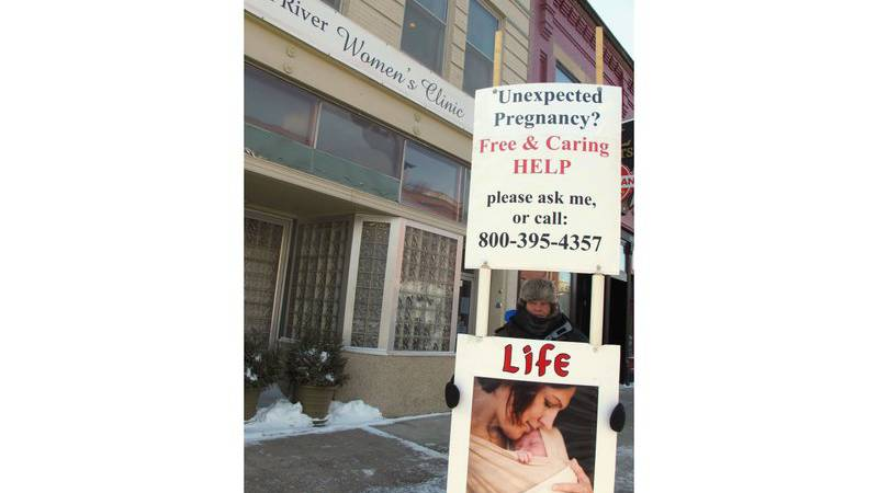 FILE - In this Feb. 20, 2013 file photo, an abortion protester stands outside the Red River...