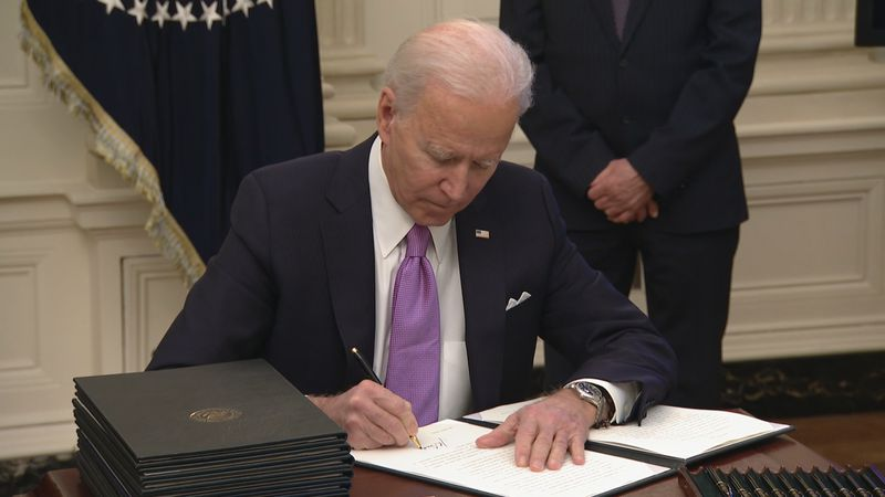 President Biden signs first executive order in the White House.