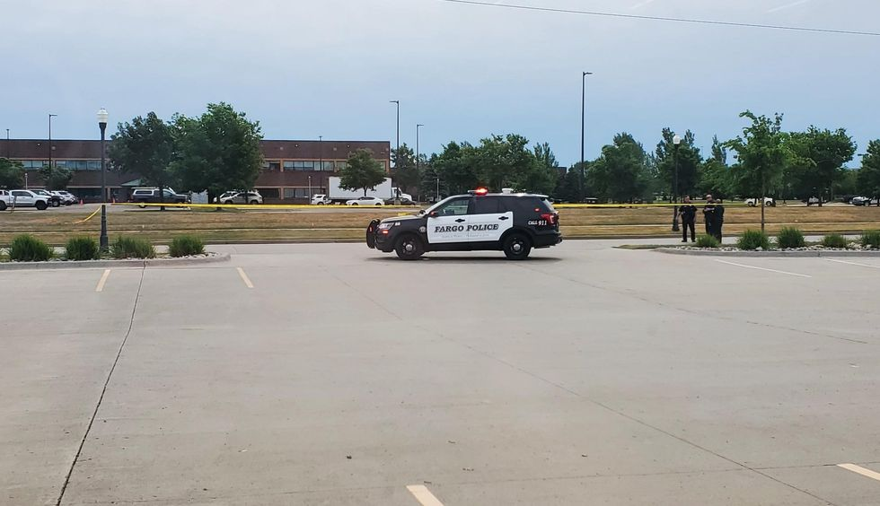 Police and crime scene tape at 43rd Street and 18th Avenue South in Fargo