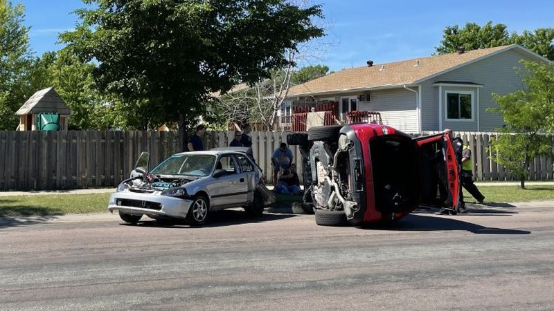 Woman trapped in car after rollover crash