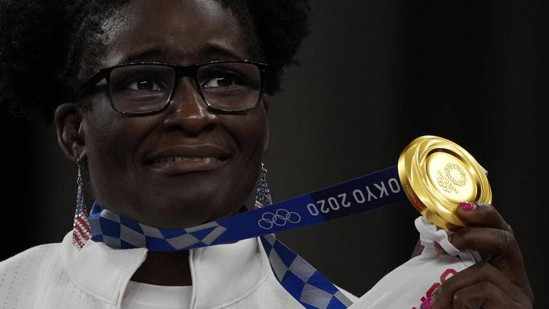 Gold medalist, United States' Tamyra Mensah-Stock celebrates on the podium during the medal...