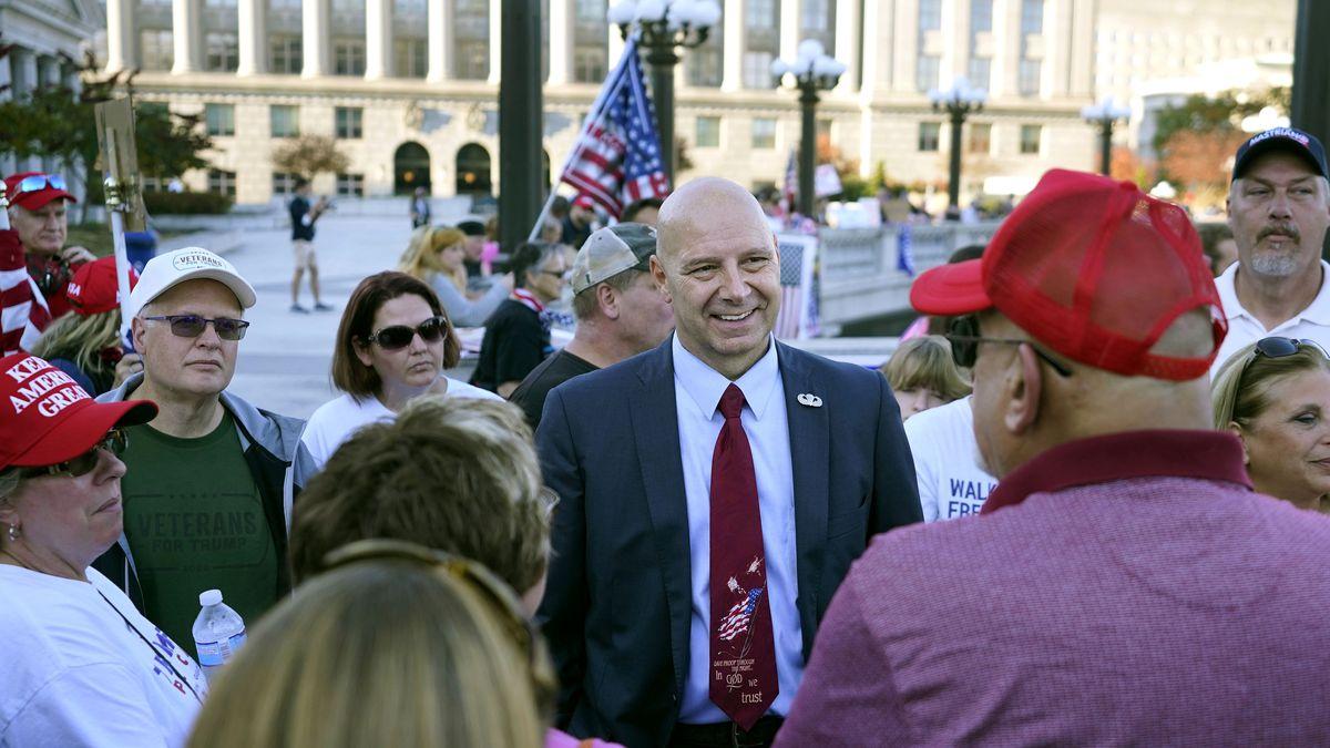 Pennsylvania state Sen. Doug Mastriano, R-Franklin, center, speaks to supporters of President...