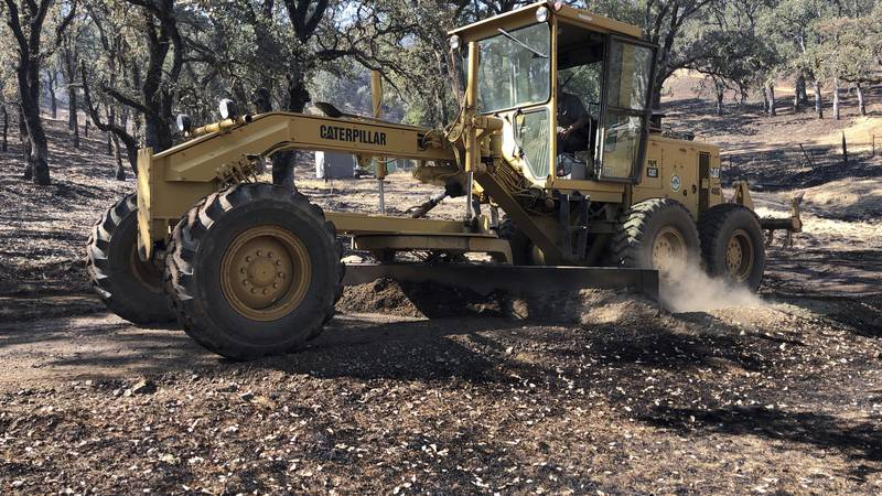 File photo of a road grader. Not the actual machine involved in the crash. (AP Photo/Jonathan...