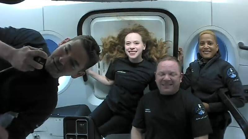 This photo provided by SpaceX shows the passengers of Inspiration4 in the Dragon capsule on...