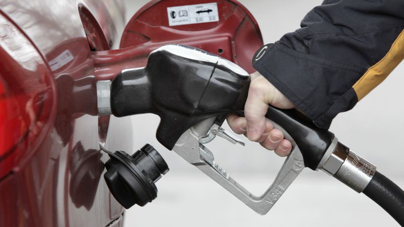 FILE - In this Jan. 22, 2010 file photo, Michael Lerner pumps gas into his car at the Speedway...
