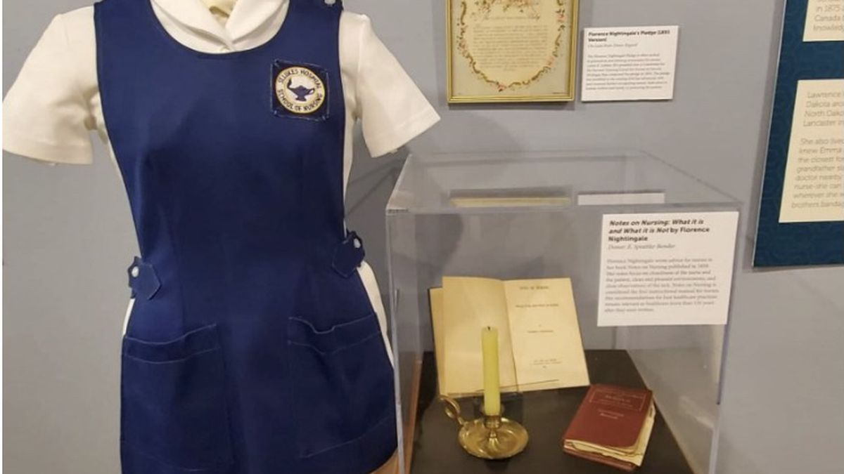 Salute to Nursing: Answering the Call exhibit showcases the uniforms, caps and pins nurses...