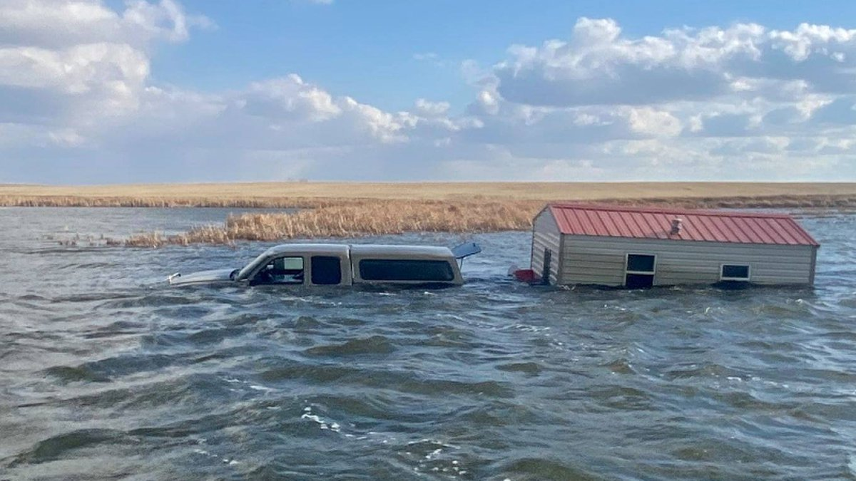 Crews had to pull this pickup and water out of a lake near Kulm, ND.