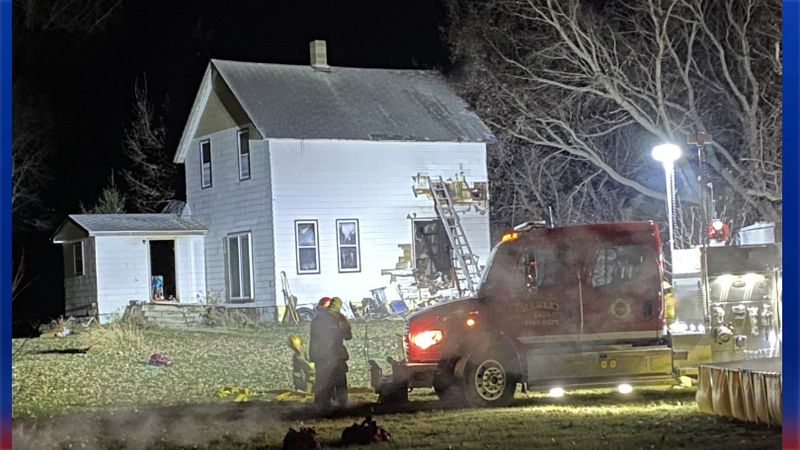 Crews were called to a house near Glyndon and saw smoke and flames coming from this home.