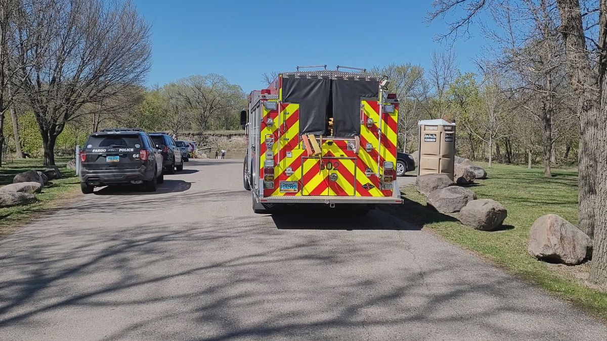 Authorities discover a body by the river near 52nd Avenue South in Fargo on May 7, 2021.
