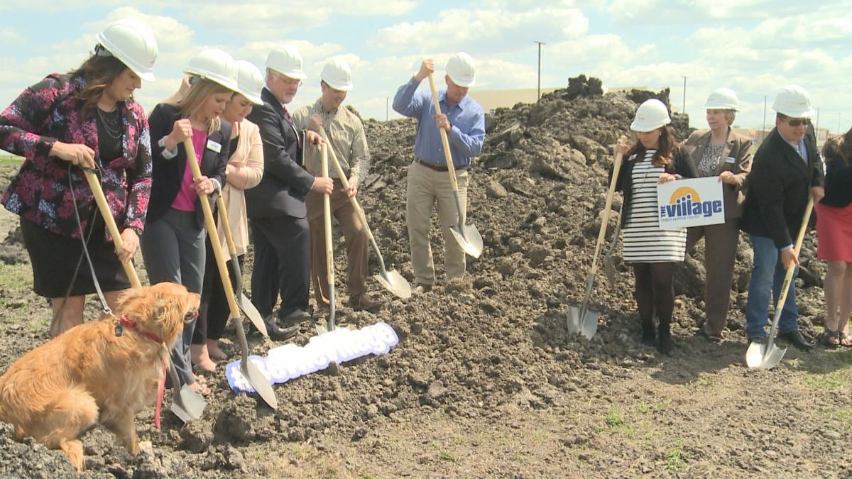 Staff members from the Village and officials from the City of Moorhead break ground on the new location set to open by the fall of 2019