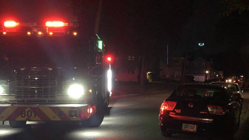 A fire truck blocks part of a Fargo road as crews dealt with a branch on a high voltage power...
