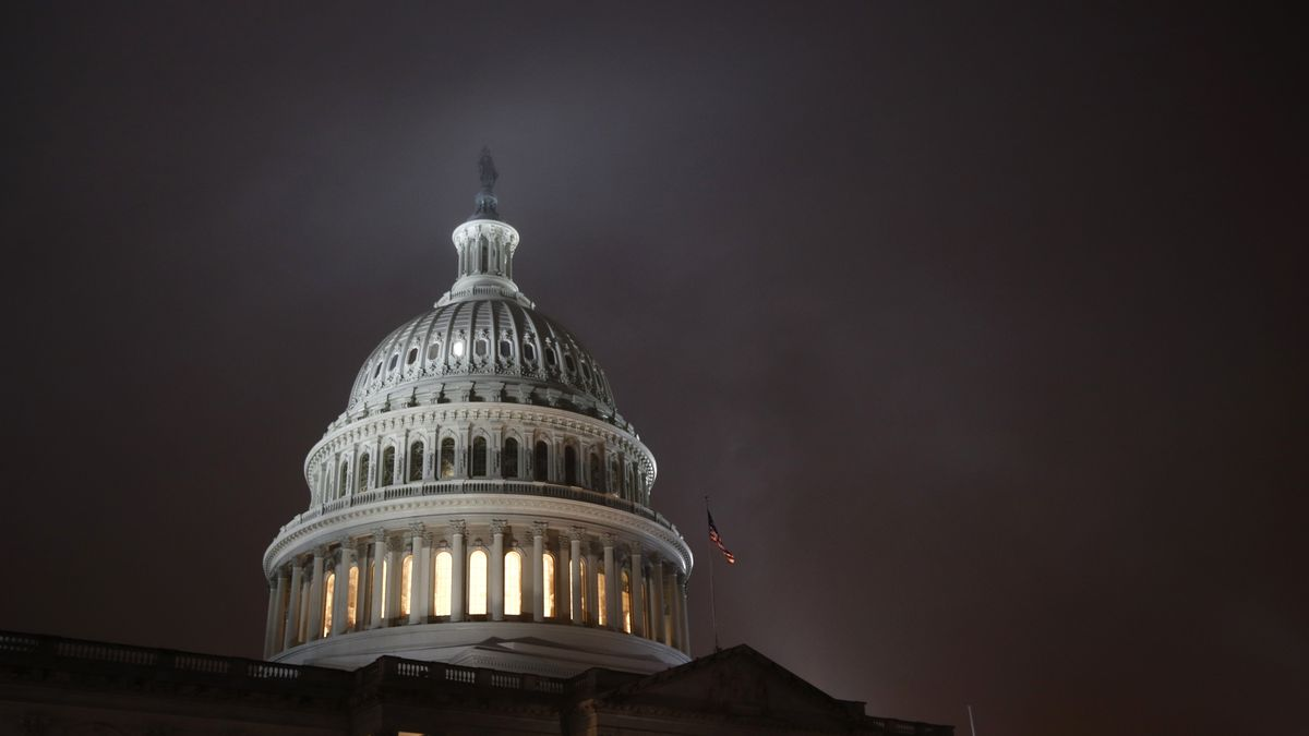 FILE - In this Dec. 9, 2019, file photo mist rolls over the U.S. Capitol dome on Capitol Hill in Washington.