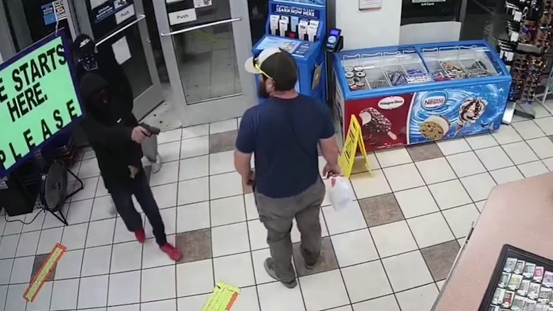 Surveillance video shows another customer in the store react immediately to the situation and...