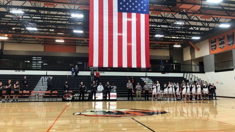 The Burley and Jerome basketball teams stand for the Star Spangled Banner, Tuesday, January 19th.