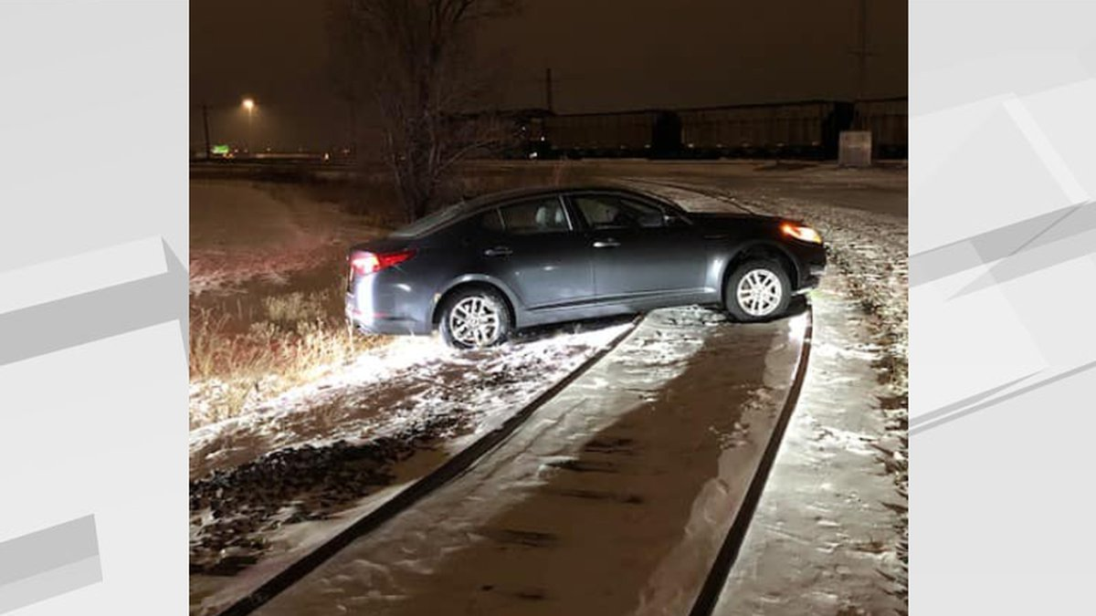 Police found this car hung-up on some trains tracks of the north-side of the city, the driver...