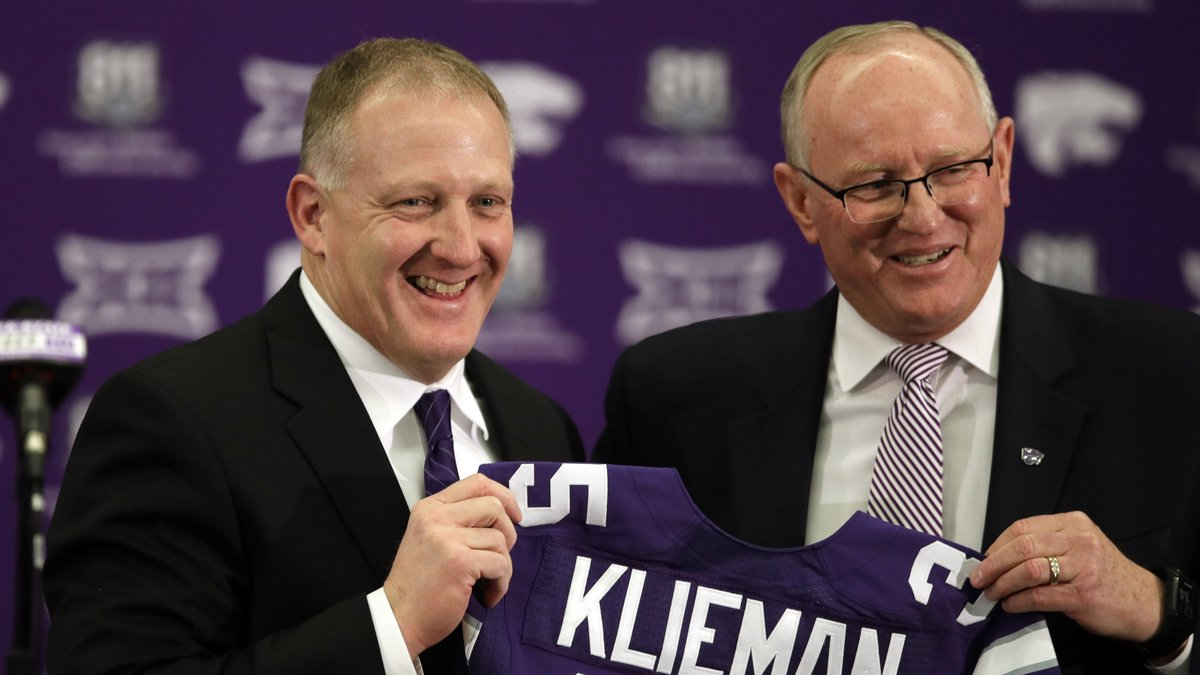 Chris Klieman, left, is introduced as the 35th Kansas State NCAA college football head coach by...