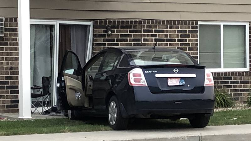 A vehicle crashed into an apartment building Thursday evening.