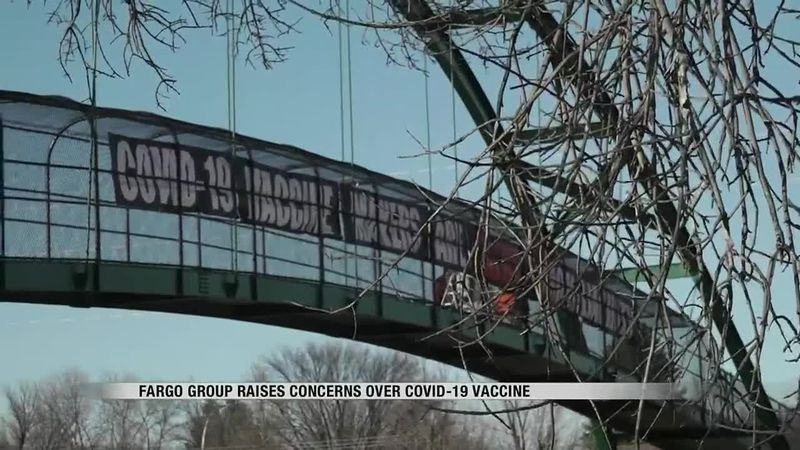 News - Local group takes to Pedestrian Bridge to raise awareness on COVID Vaccine liability