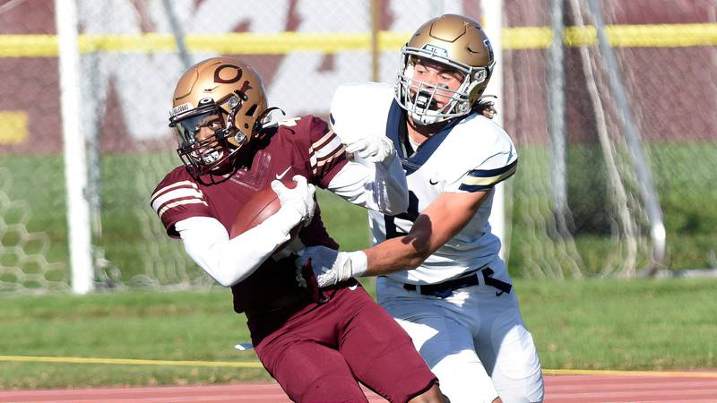 Senior Noble Scott steps in front of a Bethel receiver to make a TD-saving interception during...