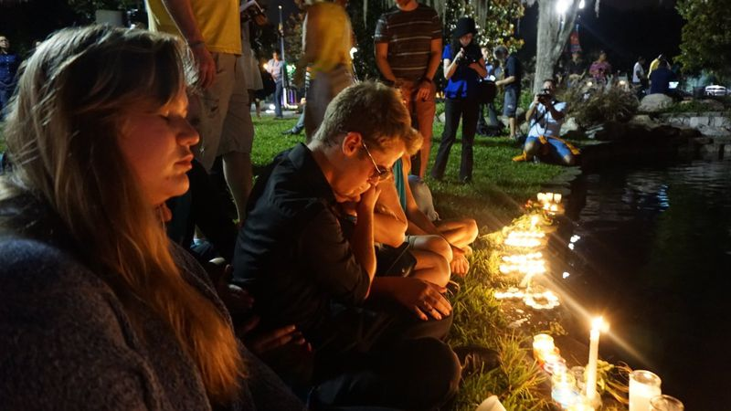 Community members mourn together to remember the lives loss at Pulse night club on Sunday,...