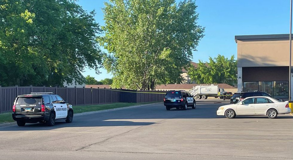 Caution tape blocks off a portion of the Party City parking lot just off of 13th avenue in Fargo.