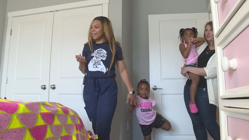 A mother and two daughters explore their new home on Tuesday, June 15.