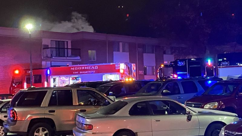 Crews are working the scene of an apartment building fire near MSUM.