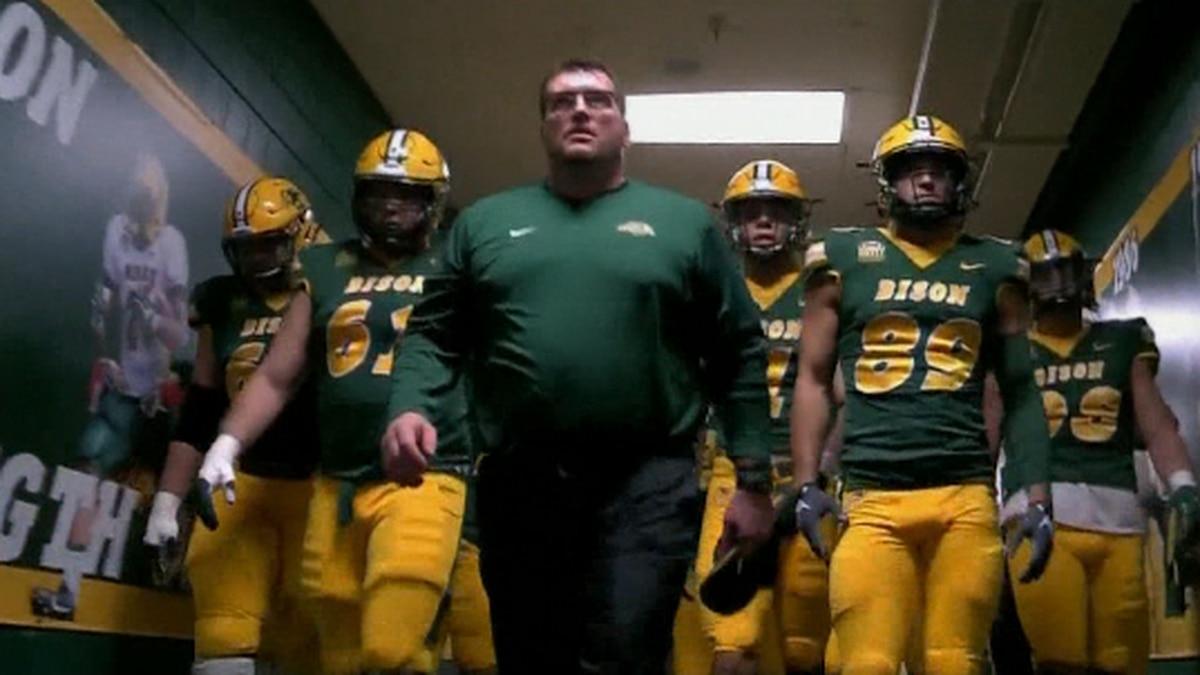 The Bison Football team hitting the field against South Dakota St.