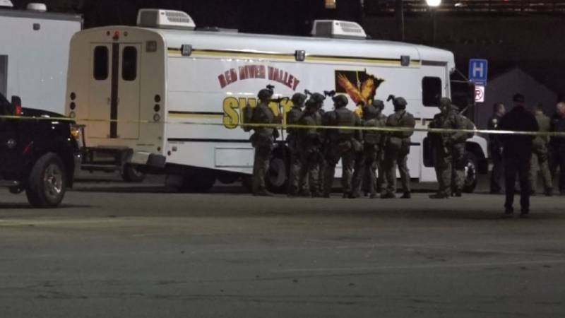 SWAT Team members gather in the neighborhood involved in the standoff.
