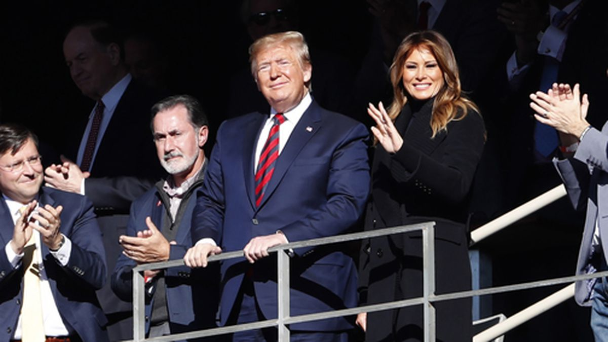 President Donald Trump watches the first half of an NCAA football game between Alabama and LSU with his wife Melania on Saturday, Nov. 9, 2019, in Tuscaloosa, Alabama. (AP Photo/John Bazemore)