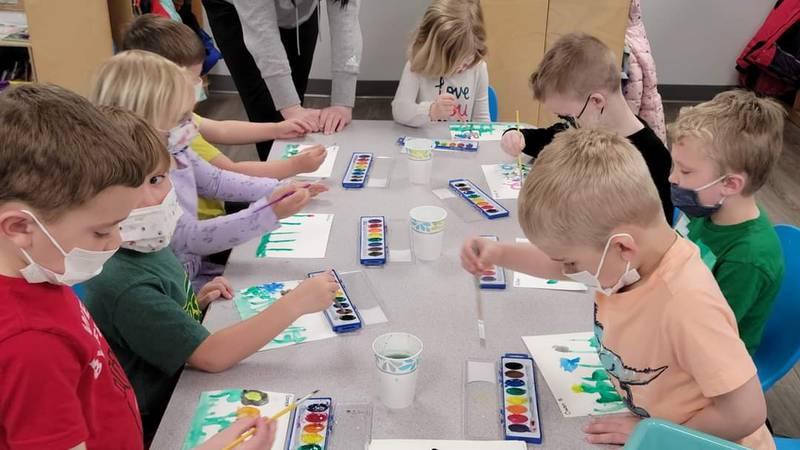 An instructor works with children at Creative Minds Preschool in West Fargo.