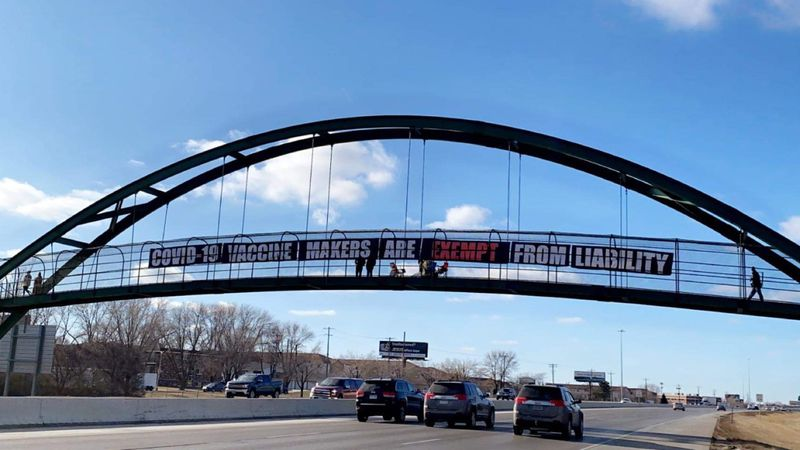 The sign was stretched across the footbridge over I-94.