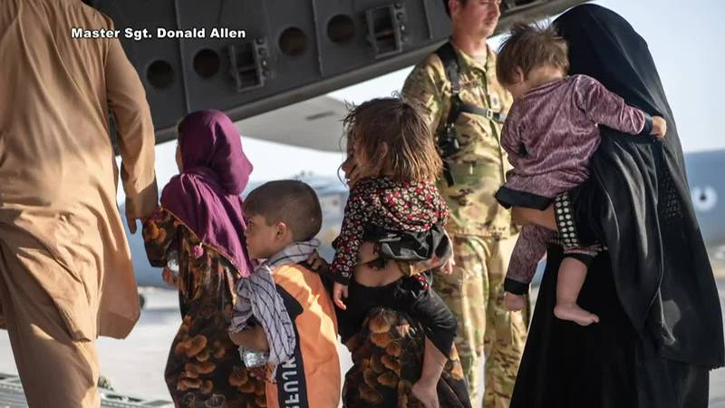 Some Afghan civilians board U.S. jets to be flown out of Afghanistan