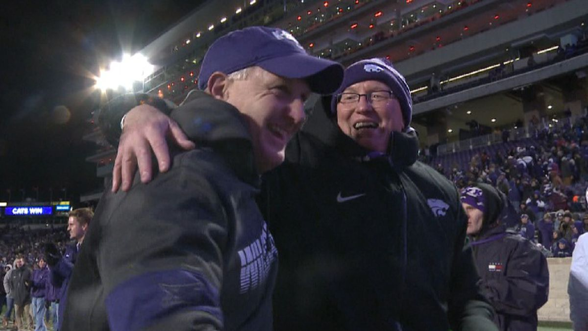 Kansas State Athletic Director Gene Taylor puts an arm around head coach Chris Klieman after the Wildcats win 27-17 over Iowa State on November 30, 2019.