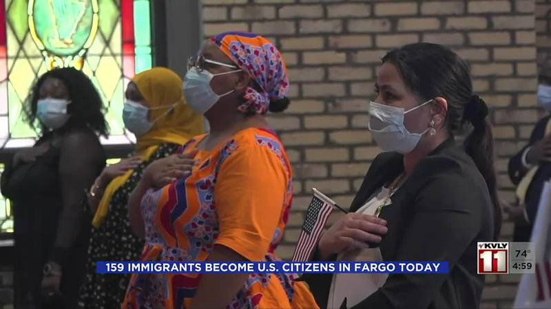 159 immigrants become naturalized citizens