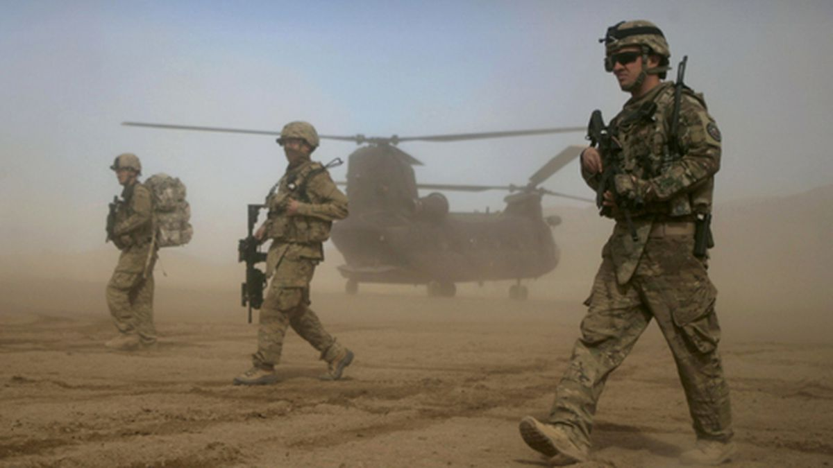 In this Saturday, Jan. 28, 2012 file photo, U.S. soldiers, part of the NATO- led International Security Assistance Force (ISAF), walk west of Kabul, Afghanistan. (AP Photo/Hoshang Hashimi, File)