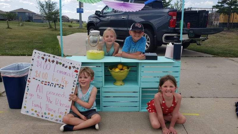 The Tollefsons helped run a lemonade stand over the weekend to help raise support for a family...