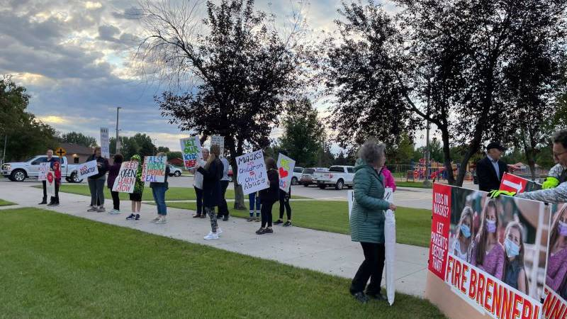 30 people gathered outside of the school to protest district's the mask requirement