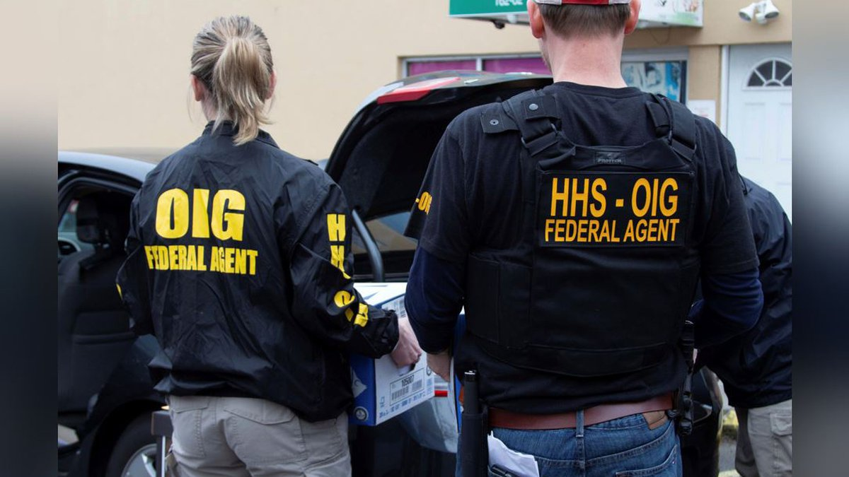 FILE - In this image provided by the Department of Health and Human Services, federal agents...
